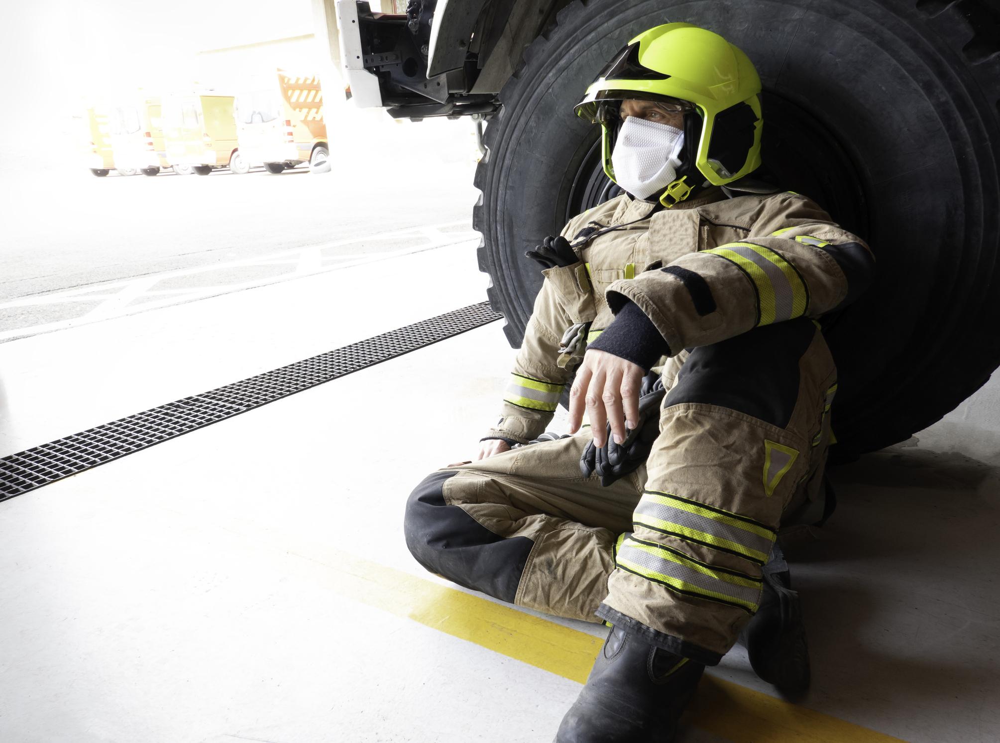 Firefighter leaning wheel