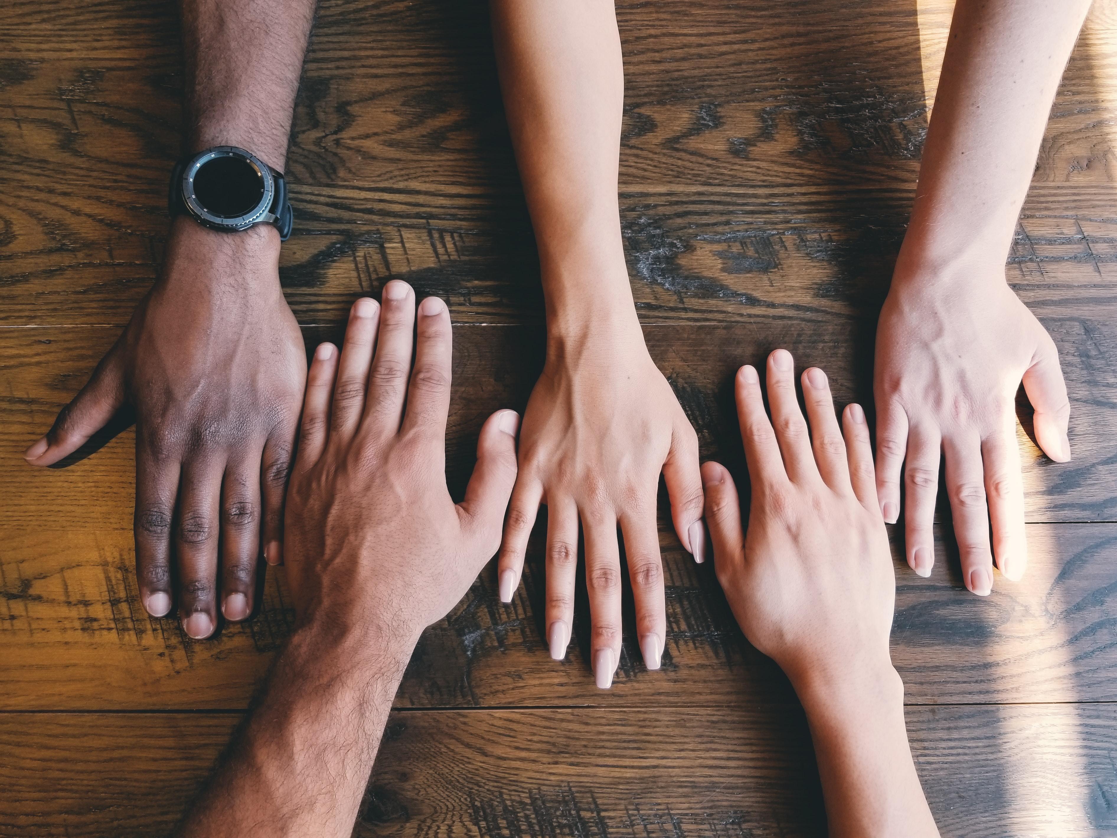 Five human hands