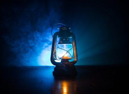 Oil Lamp Lighting up the Darkness or Burning kerosene lamp background