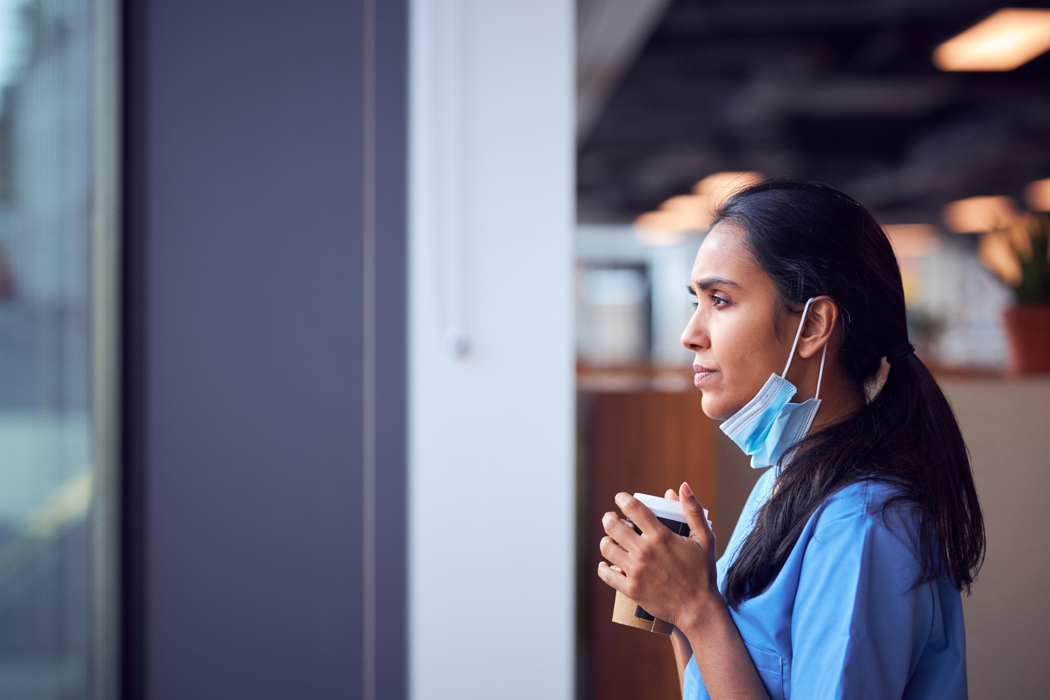 Nurse gazing through a window