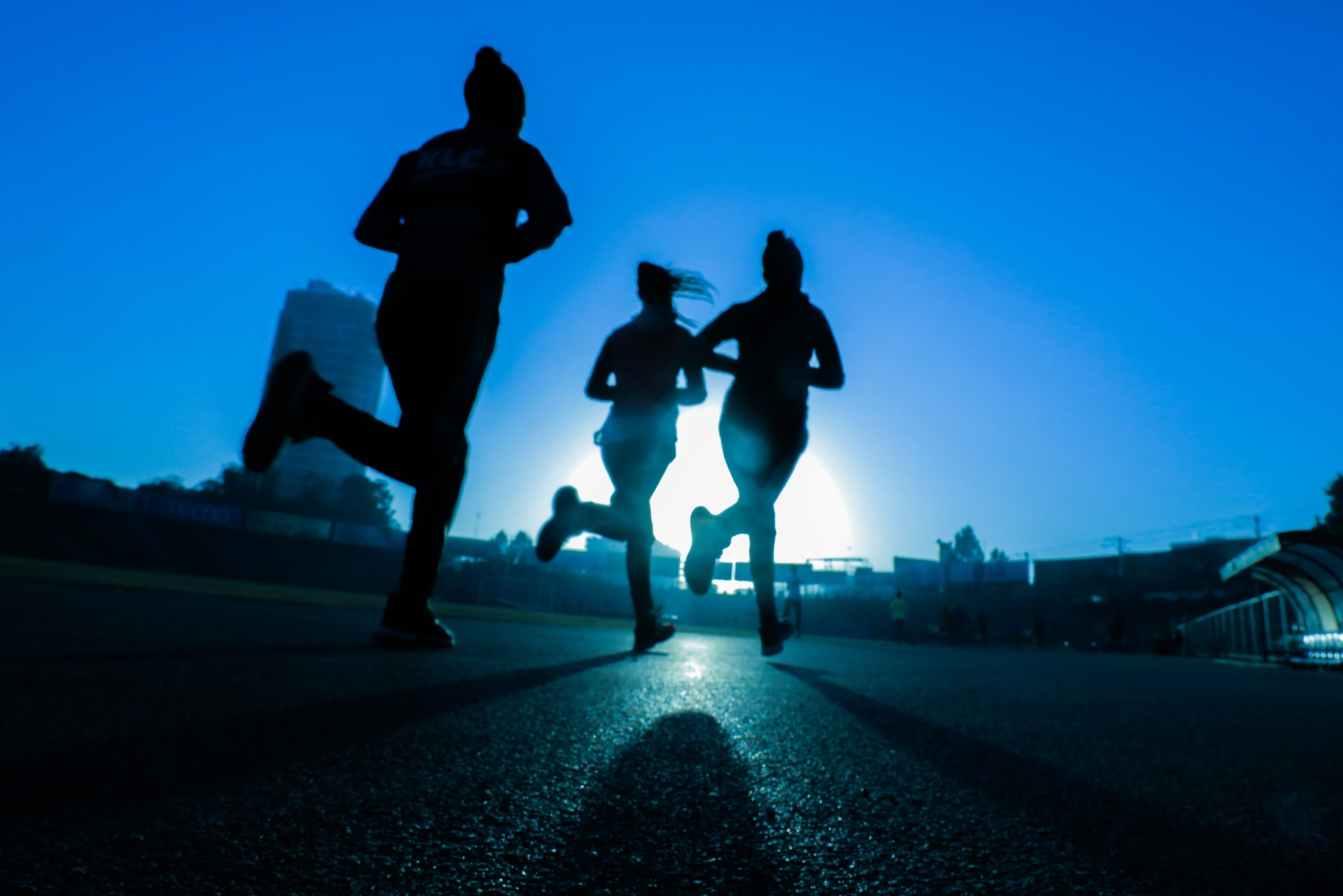Three people jogging in the dark