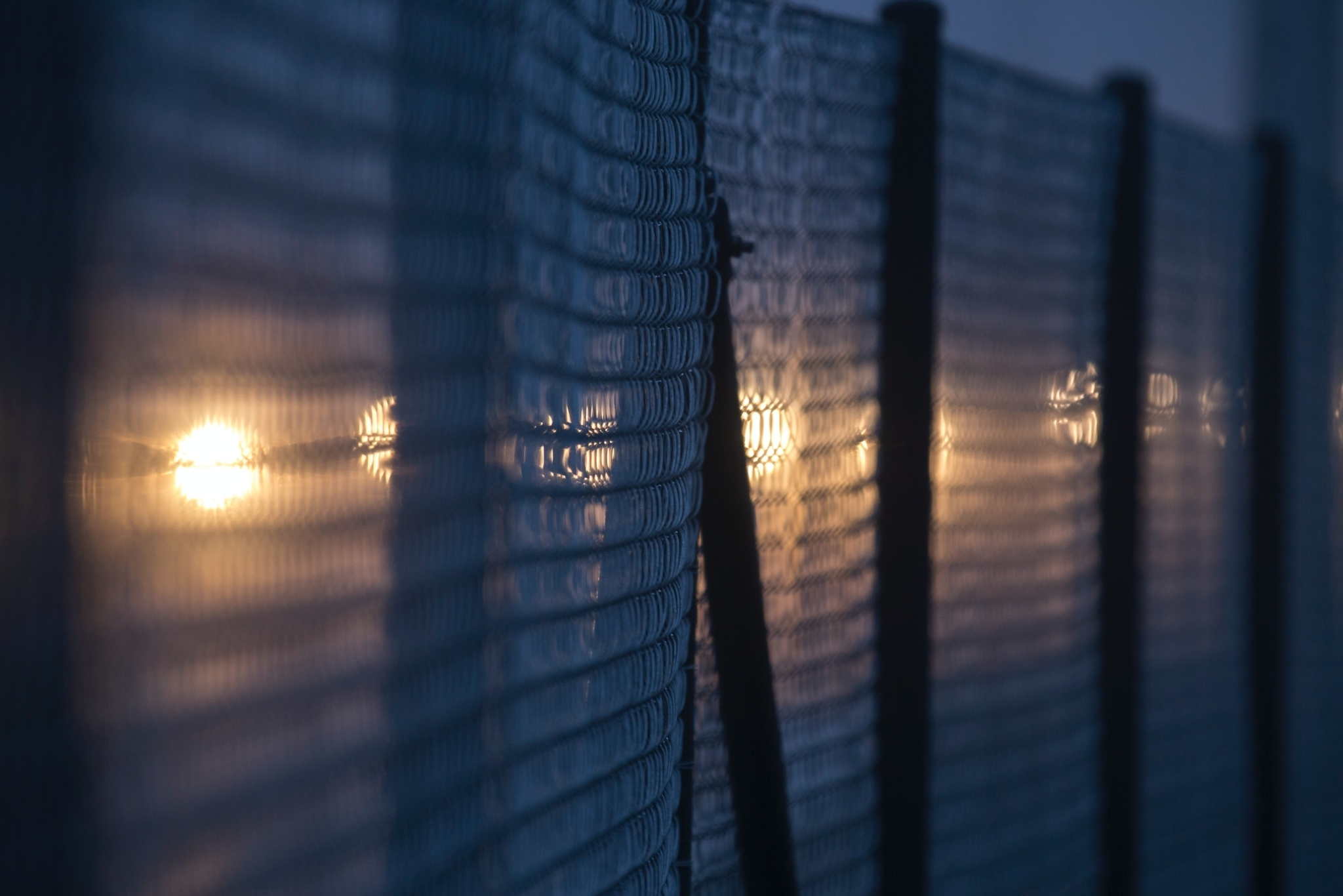 Fence with blurred lights in the background